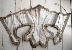 Interior of Taupe Silk Swiss Waist, circa 1860-65 via eBay | a wonderful interior photo of a Swiss waist showing the light boning and seam lines.