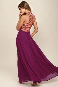 The Strappy to be Here Magenta Maxi Dress is your new fun go-to! Dreamy, lightweight Georgette sweeps across a princess-seamed bodice and strappy apron neckline, plus a lacing open back. Full maxi skirt has a bit of elastic at back. Hidden back zipper.