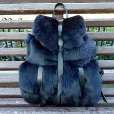 This cute backpack made of natural rabbit fur and natural leather