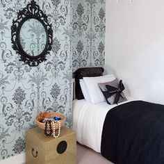 Small bedroom with damask wallpaper. Small bedrooms are a great place to experiment with colour, texture and design. The use of bold decorative wallpaper coupled with black and white linen works well in this beautiful guest bedroom.  #Sleeptember