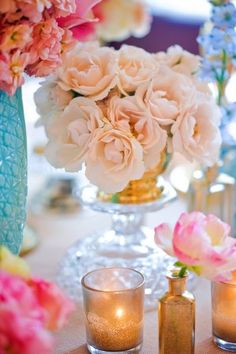 Pink and peach flowers in turquoise and gold vases by Flora Fauna | photography by http://corbingurkin.com/