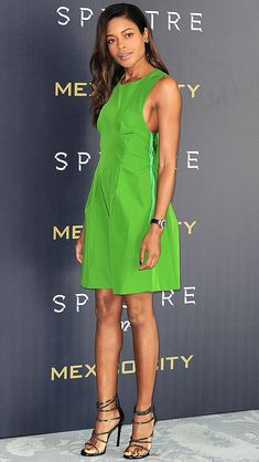 NAOMIE HARRIS i a sleeveless, bright-green Lanvin dress and black strappy Stuart Weitzman sandals at the Spectre photo call in Mexico City.