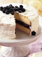 Lemon-Blackberry Cake  Just-picked blackberries, a sure sign of long, warm days and a harbinger of a season of fresh, colorful fruits, crown a tender lemon cake. Filled with cassis-spiked blackberry jam and coated with Lemon Buttercream, our Lemon-Blackberry Cake will be a treat you'll want to share with the whole family.