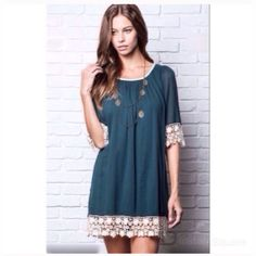 """Dark Teal Lace Trimmed Dress Super cute dark teal lace trim dress NWT. 60% cotton, 40% polyester, inside lining. Can be worn as a dress or a tunic over leggings. 33.5"""" from shoulder to bottom of lace, 19"""" across laid flat at bust but does stretch a lot more than that. Dresses Mini"""