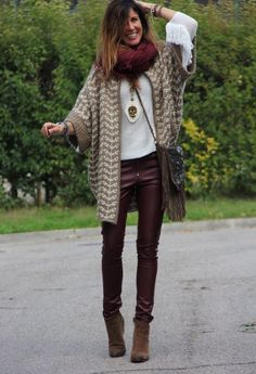 We see the infinity scarf repeated, on top of a casual sweater. A very western…