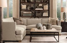 neutral living room with L shaped couch and reclaimed wood coffee table