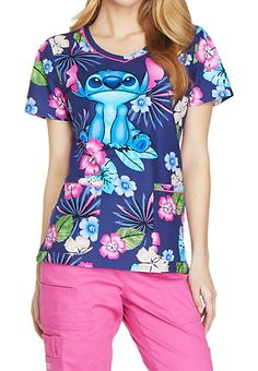QUITE THE STITCH Keep young Disney fans entertained with this Lilo and Stitch inspired print scrub top from Cherokee Tooniforms! This V-neck features a vibrant print starring Stitch himself, alongside Shocking Pink contrast piping at the neckline and pockets. Bust darts and back darts provide shaping without constriction, while side slits allow for easy movement. Two large patch pockets provide all the room you'll need for medical accessories. Cherokee Tooniforms Stitch V-neck Print ...