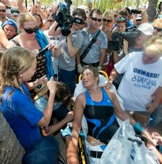 Diana Nyad getting medical attention after a 111 mile swim from Cuba to Key West~photo by Andy Newman