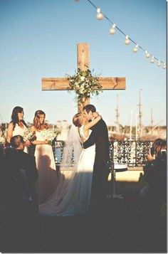 LOVE the cross in the background. Great idea for outdoor wedding: