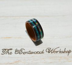 Bentwood ebony ring ebony wood ring opal ring wedding | Etsy Opal Wedding Rings, Opal Rings, Wedding Ring Bands, Gemstone Rings, Wood Inlay Rings, Wood Rings, Wood Inlay Wedding Band, Ring Pictures, Rings For Men