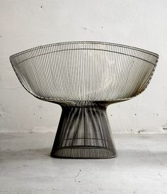 By Warren Platner.  Studied architecture at Cornell University. Following his work with legendary designers Raymond Loewy, Eero Saarinen and I. M. Pei, he immersed himself in the creation of steel wire furniture, devising the method and tooling to produce the lounge chair in the line as well.