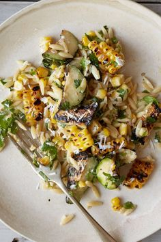 F&W's Kay Chun takes pasta salad to a new level with sweet grilled corn zucchini and a creamy lime dressing spiked with chile powder. She uses fresh cilantro to add brightness and then tops the whole salad with tangy slivers of fresh goat cheese. Think Food, Food For Thought, Vegetarian Recipes, Cooking Recipes, Healthy Recipes, Amish Recipes, Dutch Recipes, Veggie Recipes, Orzo Salat
