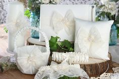 Delilah collection set by Ivy Lane Design Lace bow ring bearer pillow, guest book with pen, garter set, flower girl basket and unity candle.