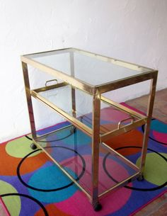 amazing modernist  hOLLYWOOD  rEGENCY rolling bRASS  BAR CART  tea Trolley Table with removable TRAY. $894.00, via Etsy.