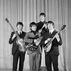 The Beatles at a photo shoot the day before their first appearance on THE ED SULLIVAN SHOW. From left: Paul McCartney, George Harrison, Ringo Starr, John Lennon. Image dated February 8, 1964.