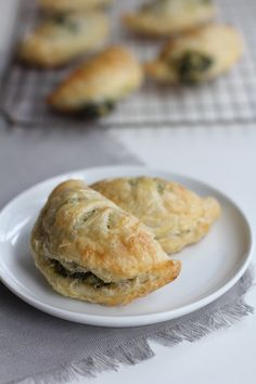 """Spinach and Artichoke Dip Hand Pies """"Pasties"""" (makes about 20 pieces, depending on size - 35 minutes: 1 C thawed and well-drained finely chopped frozen spinach, 1 1/2 C thawed finely chopped frozen artichoke hearts, 6 oz cream cheese softened to room temp, ¼ C mayo, ½ C grated Parmesan, salt, pepper, 1 14 oz package all-butter puff pastry thawed in the refrigerator, and 1 egg white lightly beaten)"""