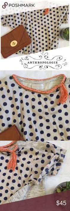 Anthropologie polka dot top Corey Lynn Calter for Anthropologie. Navy polka dots on the front with contrasting heather textured back. Exquisite gold detail around collar with orange fringe tassel. Anthropologie Tops
