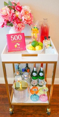 Colorful bar cart decorating ideas! Wish I bought a dozen more Lilly Pulitzer cocktail glasses | Columbia Apartment Tour: How to Decorate a Temporary Apartment on a Budget by southern blogger Diary of a Debutante