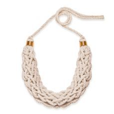 Saloukee Tisa bib necklace: Description: A bold yet lightweight, beautifully tactile, hand woven, bib necklace. The word 'Tisa' is the Ethiopian Mursi tribes word for 'plait' and hints at the origin of just some of the inspirations for the White // Wood collection.