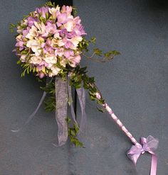 Flower girl wands...so cute and easy to make with directions here http://www.ehow.com/how_7345113_make-flower-wands.html