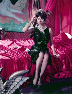 sophia loren on a pink satin bed