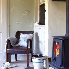 Cosy living room with woodburning stove and leather chair