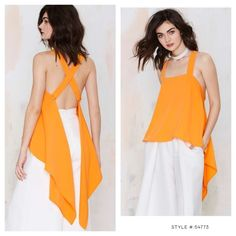NASTY GAL / ASILIO CHANNEL ORANGE TOP SAFFRON SOLD OUT! Showstopper piece! ASILIO Channel Orange Asymmetric Top in Saffron. size L / US8 .{few small ink transfer marks at end corner of one of the pieces that hang down will prob come out when washed} The Channel Orange Top by Asilio has thick crossed shoulder straps, an asymmetric hem, and button closures back. Partially lined, split back. Throw it on with high-waisted skinnies and take some seriously dramatic photos. *Polyester/Spandex…