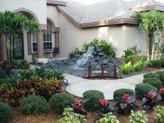 Front yard design ideas fountain Buchsbaumkugel stones