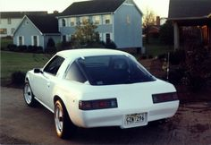 "My 1980 RX7 customized by Mullikin's Corvette in 1989. 81 tail lights with an 80 corvette lower rear end. Sides were rolled and molding was removed. 15"" ARE wheels."