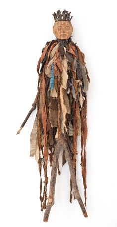 """Spirit Figure  Louisiana, Circa 1930  Carved and Painted Wood  with Rag and Mixed Media  36""""H x 17""""W x 4""""D"""