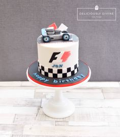 Formula 1 and Lewis Hamilton inspired birthday cake. Topped with race track, racing car and chequered boarder.  A simple but impactful cake that was chocolate sponge inside with chocolate and vanilla buttercream and chocolate ganache undercoat. Made by www.deliciouslydivine.co.uk
