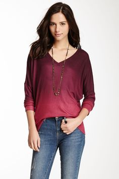 A: Got to love a well-done ombre. And what a nice color. Would pair with black or dark jeans, not these lighter ones.