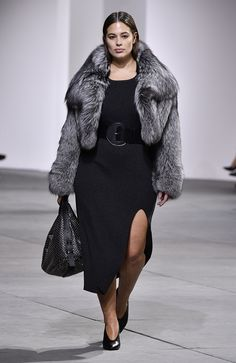 Ashley Graham wears fur jacket and black dress from Michael Kors Collection fall-winter 2017