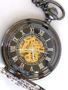 Pocket watch with visible workings.