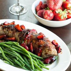 Enjoy a classy dinner for two with a delicious pork tenderloin topped with strawberries. You're partner will definitely be impressed. Shop the recipe here! #strawberries #delicious #dinnerfortwo