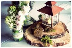 Wood slabs, lanterns, moss, mason jars. Just a few of my favorite things!