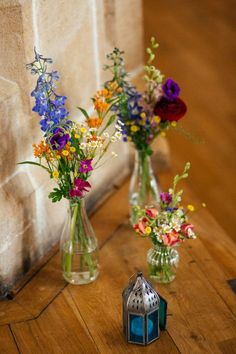 Rainbow Colourful Bottle Flowers Wild Natural Decor Multicoloured Fun Creative Wedding http://www.catlaneweddings.com/