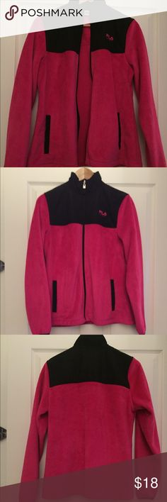 Zip up! This is in great condition! Perfect to throw on in the fall and winter. I posted a picture of what the material feels like, super soft and only worn once or twice. Zips all the way down Fila Jackets & Coats