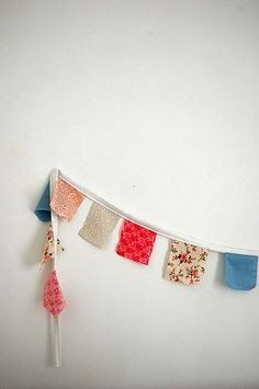 I think my kitchen needs some square bunting, in place of curtains.  ::bunting, via Flickr.