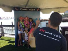 """Get Lei'd Party at Pier 13 in Hoboken!  For this event we provided a custom """"Big Wave"""" backdrop, surfboard props and a great energetic team to promote Pier 13 and provide customers with an amazing instant branded photo take-away!"""