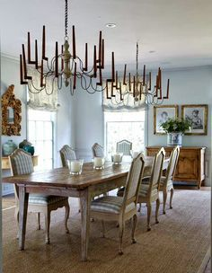 A House Romance: French furniture and delicate antique chandeliers