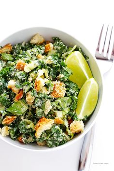 Kale Caesar Salad -- made with a light and delicious lime Caesar dressing | via Gimme Some Oven
