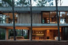 «Design firm @atvarquitectos crafts a two-story cabin out of concrete and timber in the woodlands of Pinamar, Buenos Aires Province, Argentina. Photo:…»