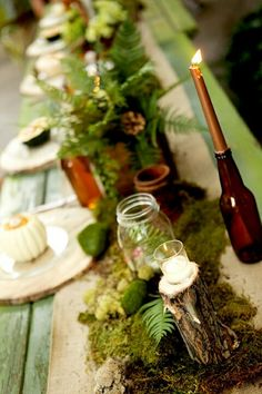 Woodland table decorations - This is pretty. I like the ferns, the wood, and the jars...I know Blake would like the moss.
