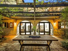 I quite like a number of elements in this photos - doors, windows with shutters, courtyard with overhanging vines...