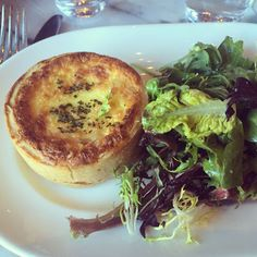 Individual quiche with baby greens salad and champagne vinaigrette dressing