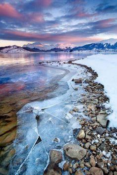 Ushuaia, Argentina I like how the snow and ice is divided by the rocks. I also like how the colors of the sky are reflected on the ice. Ushuaia, Places To Travel, Places To See, Places Around The World, Around The Worlds, Beautiful World, Beautiful Places, Beautiful Sunset, Amazing Places
