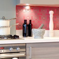 Brilliant idea! Instead of tiling a backsplash, stencil something onto it! You still get the statement that comes from a bold pattern and colors without the expense.