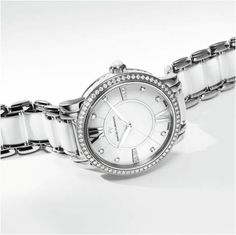 Is it too early to start dreaming of a white Christmas?  The Classic® in glossy white ceramic has a diamond bezel and numeral markers that sparkle like freshly-fallen snow.