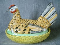 Victorian, circa 1870 Large Staffordshire hen on nest tureen. Modeled as a colorful hen sitting on her eggs on top of a basket. The hen forms the cover,